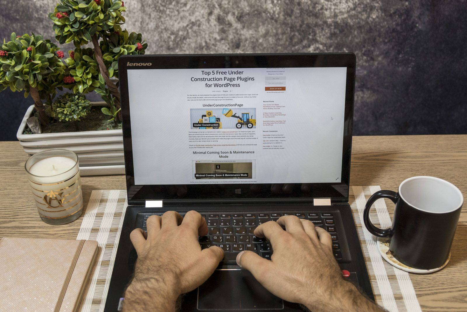 A laptop screen showing an article about under construction plugins