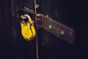 selective focus photography of yellow padlock